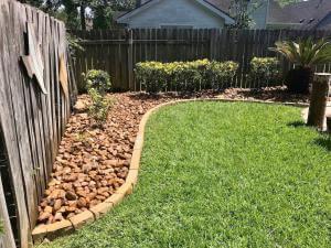 backyard landscape design rock and gravel stone edging houston tx 77407