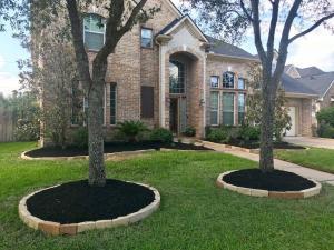 front yard landscape after stone edging black mulch houston tx 77407