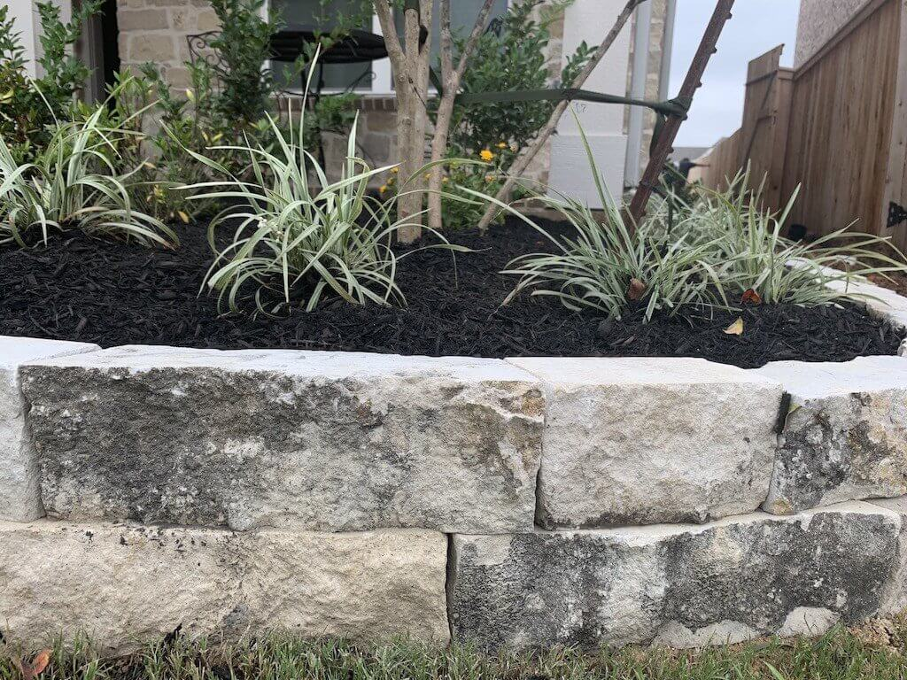 landscape edging double stacked chopped stone gray limestone houston tx 77407